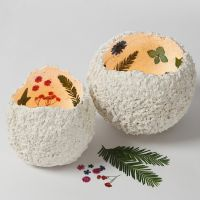 Lanterns from papier-mâché pulp decorated with dried flowers
