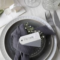 Place cards in off-white shades with a punched-out church and vellum paper
